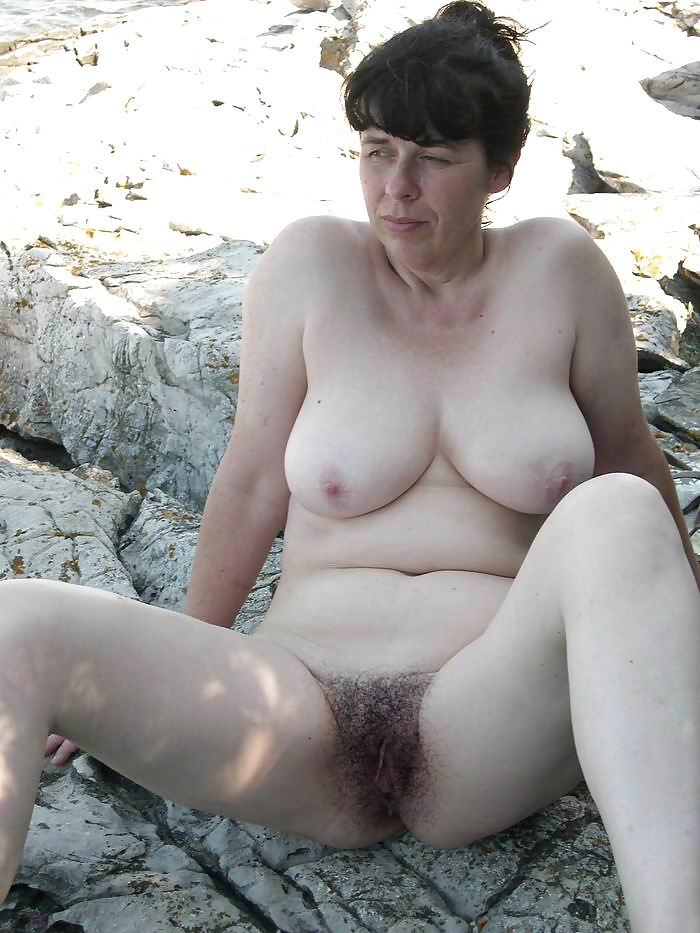 Busty mature spied in public shower 10